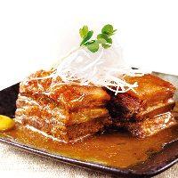 ラフテー 沖縄産三枚バラ肉を特製味噌だしで炊いた自慢の角煮。